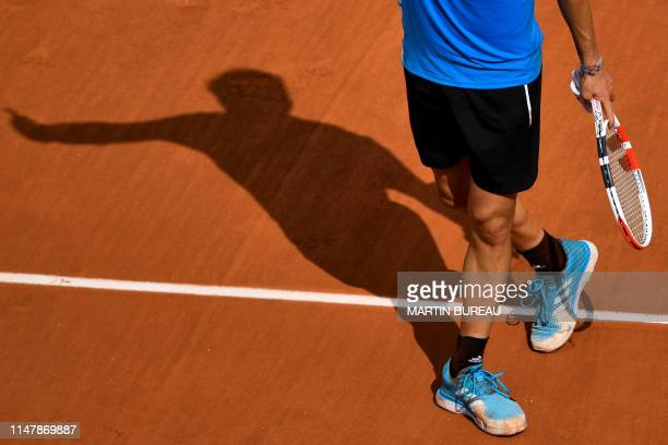 Austria's Dominic Thiem celebrates after winning against France's Gael Monfils during their men's singles fourth round match on day nine of The...