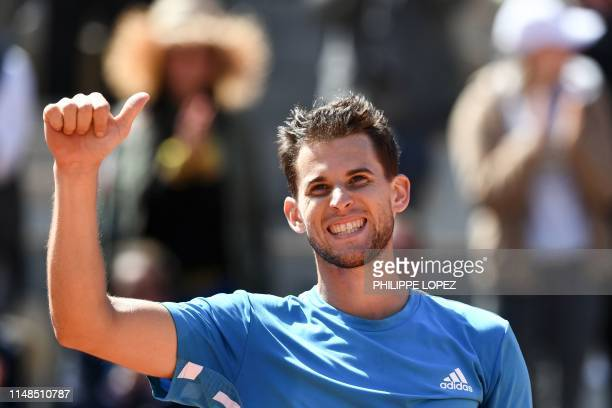 TOPSHOT Austria's Dominic Thiem celebrates after winning against Serbia's Novak Djokovic during their men's singles semifinal match on day fourteen...