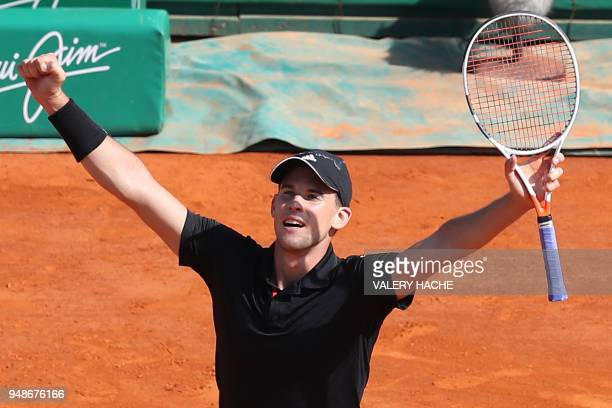 TOPSHOT Austria's Dominic Thiem celebrates after winning his men's single tennis match against Serbia's Novak Djokovic at the MonteCarlo ATP Masters...