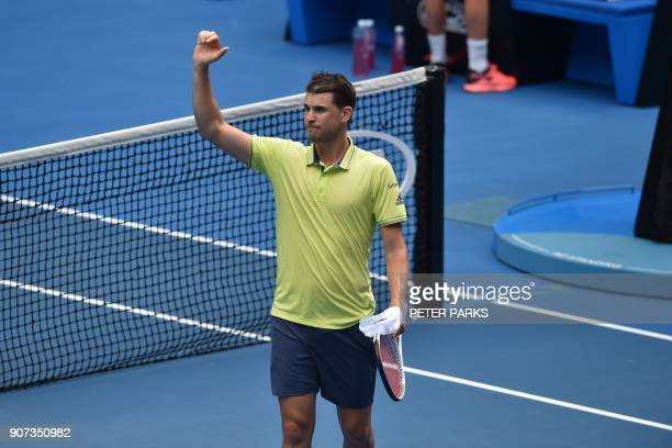 Austria's Dominic Thiem celebrates beating France's Adrian Mannarino in their men's singles third round match on day six of the Australian Open...