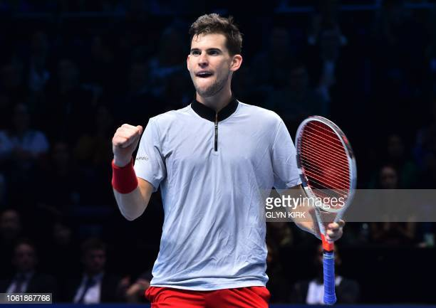 Austria's Dominic Thiem celebrates beating Japan's Kei Nishikori during their men's singles round-robin match on day five of the ATP World Tour...
