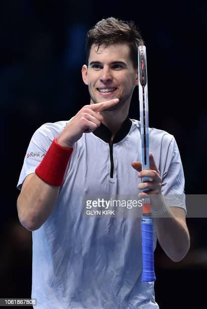 Austria's Dominic Thiem celebrates beating Japan's Kei Nishikori during their men's singles roundrobin match on day five of the ATP World Tour Finals...
