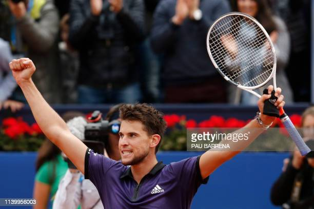 Austria's Dominic Thiem celebrates defeating Russia's Daniil Medvedev after winning the ATP Tour Barcelona Open final tennis match in Barcelona on...