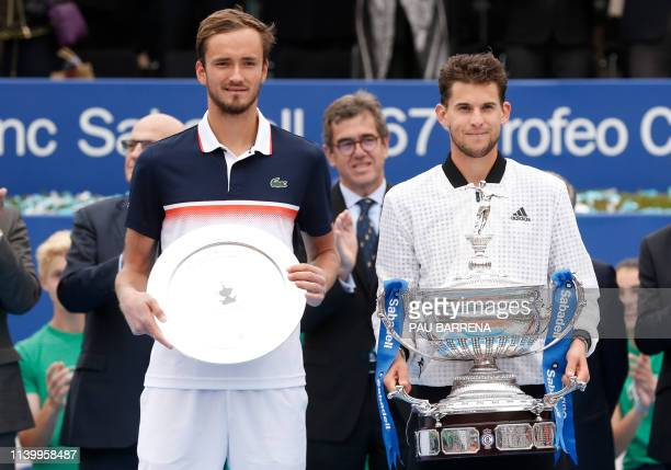 Austria's Dominic Thiem celebrates on the podium after defeating Russia's Daniil Medvedev during the ATP Tour Barcelona Open final tennis match in...