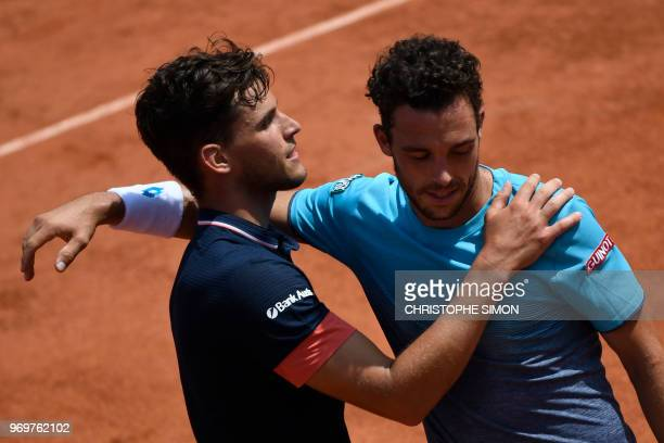 TOPSHOT Austria's Dominic Thiem embraces as he celebrates after victory over Italy's Marco Cecchinato in their men's singles semifinal match on day...