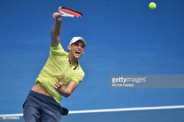 Austria's Dominic Thiem hits a return against France's Adrian Mannarino during their men's singles third round match on day six of the Australian...