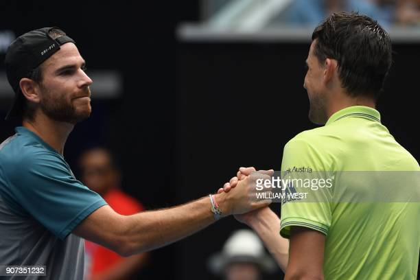 Austria's Dominic Thiem is congratulated by France's Adrian Mannarino for his victory in their men's singles third round match on day six of the...