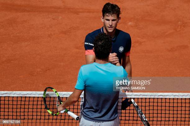Austria's Dominic Thiem is congratulated by Italy's Marco Cecchinato after winning at the end of their men's singles semifinal match on day thirteen...