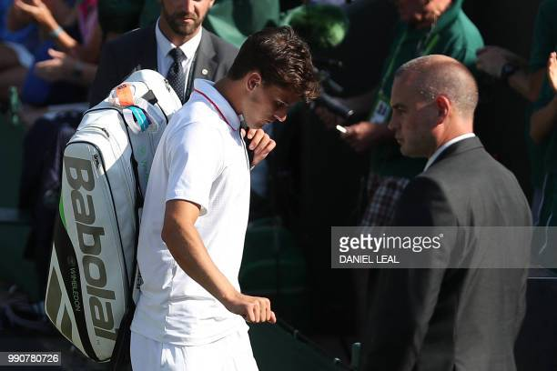 Austria's Dominic Thiem leaves court 2 after retiring against Cyprus' Marcos Baghdatis during their men's singles first round match on the second day...