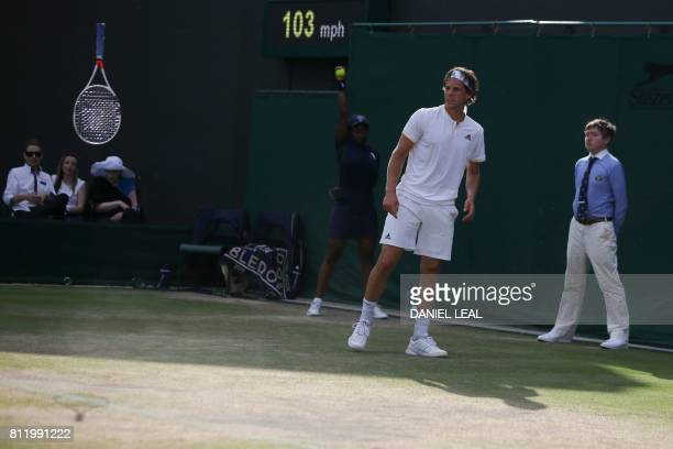 Austria's Dominic Thiem looks on after throwing his racquet during a game against Czech Republic's Tomas Berdych during their men's singles fourth...