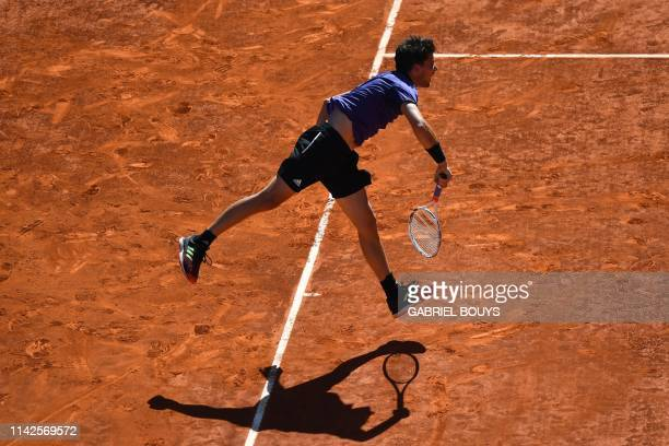 TOPSHOT Austria's Dominic Thiem plays against Switzerland's Roger Federer during their ATP Madrid Open quarterfinal tennis match at the Caja Magica...