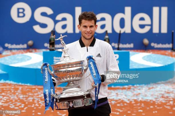 Austria's Dominic Thiem poses with his trophy after defeating Russia's Daniil Medvedev during the ATP Tour Barcelona Open final tennis match in...