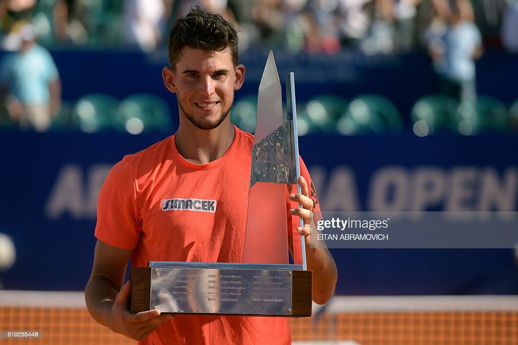 Austria's Dominic Thiem poses with his trophy after defeating Spain's Nicolas Almagro 6-7, 6-3, 7-6 during the ATP Argentina Open in Buenos Aires, Argentina, on February 14, 2016.