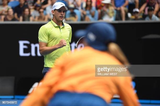 Austria's Dominic Thiem reacts against France's Adrian Mannarino during their men's singles third round match on day six of the Australian Open...