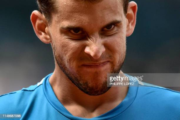 Austria's Dominic Thiem reacts as he plays against Spain's Rafael Nadal during their men's singles final match on day fifteen of The Roland Garros...