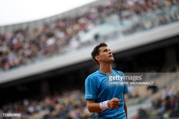 Austria's Dominic Thiem reacts during his men's singles second round match against Kazakhstan's Alexander Bublik on day five of The Roland Garros...