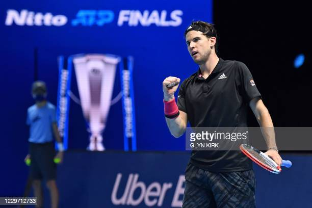 Austria's Dominic Thiem reacts to taking it to 6-5 in the third set against Serbia's Novak Djokovic during their men's singles semi-final match on...