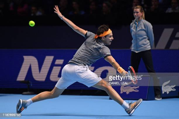 TOPSHOT Austria's Dominic Thiem returns against Germany's Alexander Zverev during the men's singles semifinal match on day seven of the ATP World...