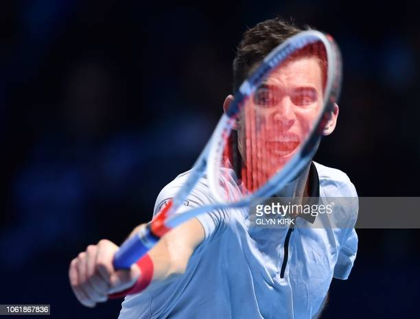 Austria's Dominic Thiem returns against Japan's Kei Nishikori during their men's singles roundrobin match on day five of the ATP World Tour Finals...