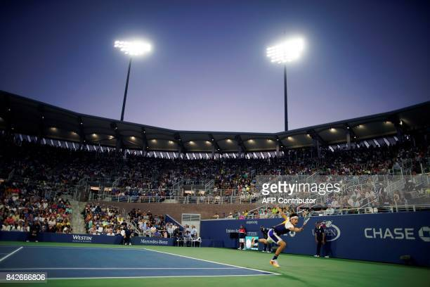 TOPSHOT Austria's Dominic Thiem returns the ball to Argentina's Juan Martin del Potro during their 2017 US Open Men's Singles Round 4 match at the...