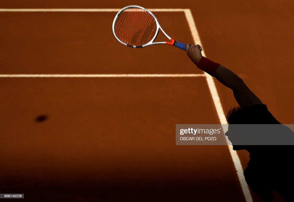 TOPSHOT - Austria's Dominic Thiem returns the ball to Germany's Alexander Zverev during their ATP Madrid Open final tennis match at the Caja Magica in Madrid on May 13, 2018.