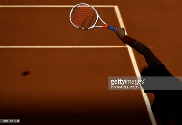 TOPSHOT Austria's Dominic Thiem returns the ball to Germany's Alexander Zverev during their ATP Madrid Open final tennis match at the Caja Magica in...