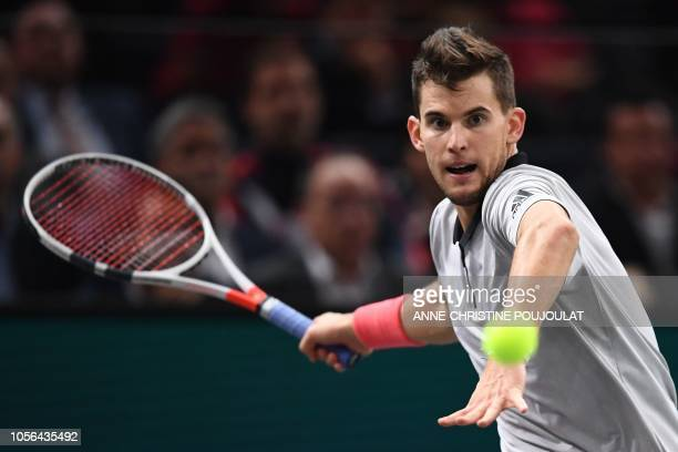 Austria's Dominic Thiem returns the ball to Jack Sock of the US during their men's singles quarter-final tennis match on day five of the ATP World...