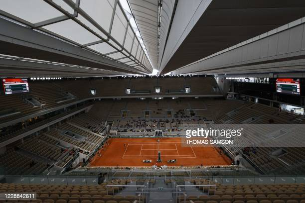 Austria's Dominic Thiem returns the ball to Norway's Casper Ruud during their men's singles third round tennis match at the Philippe Chatrier court...