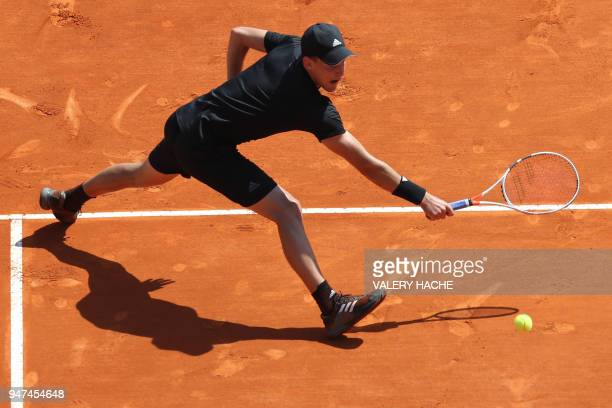 Austria's Dominic Thiem returns the ball to Russia's Andrey Rublev during their tennis match as part of the MonteCarlo ATP Masters Series Tournament...