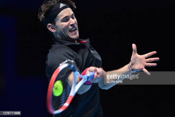 Austria's Dominic Thiem returns to Serbia's Novak Djokovic during their men's singles semi-final match on day seven of the ATP World Tour Finals...