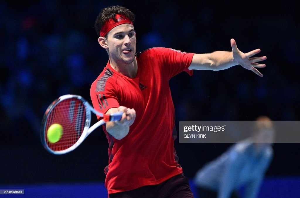 Austria's Dominic Thiem returns to Spain's Pablo Carreno Busta during their men's singles round-robin match on day four of the ATP World Tour Finals tennis tournament at the O2 Arena in London on November 15 2017. / AFP PHOTO / Glyn KIRK