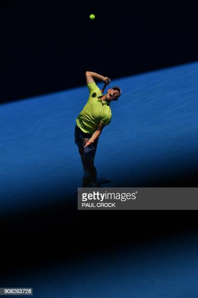 Austria's Dominic Thiem serves against Denis Kudla of the US during their men's singles second round match on day four of the Australian Open tennis...