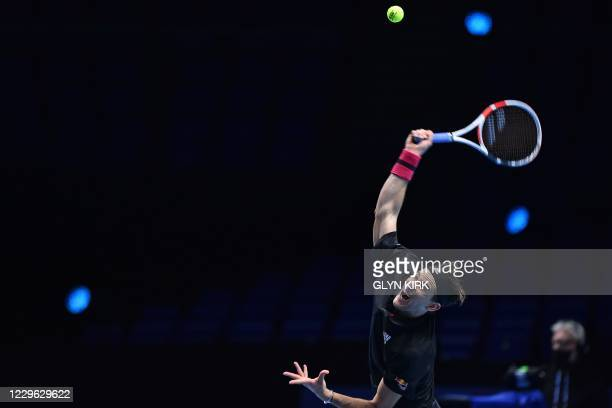Austria's Dominic Thiem serves against Greece's Stefanos Tsitsipas in their men's singles round-robin match on day one of the ATP World Tour Finals...