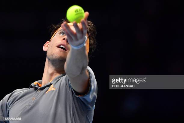 Austria's Dominic Thiem serves against Italy's Matteo Berrettini during their men's singles roundrobin match on day five of the ATP World Tour Finals...