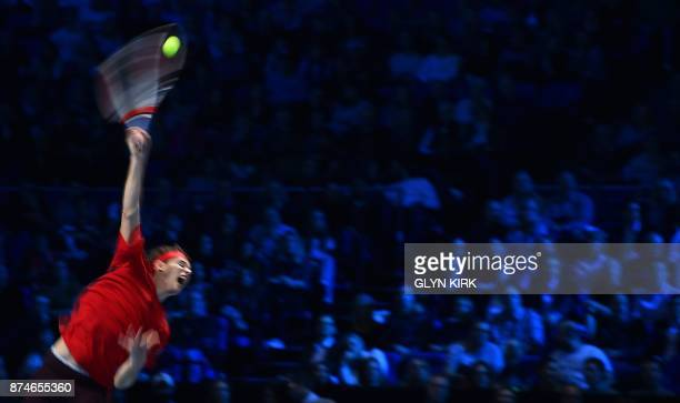TOPSHOT Austria's Dominic Thiem serves to Spain's Pablo Carreno Busta during their men's singles roundrobin match on day four of the ATP World Tour...