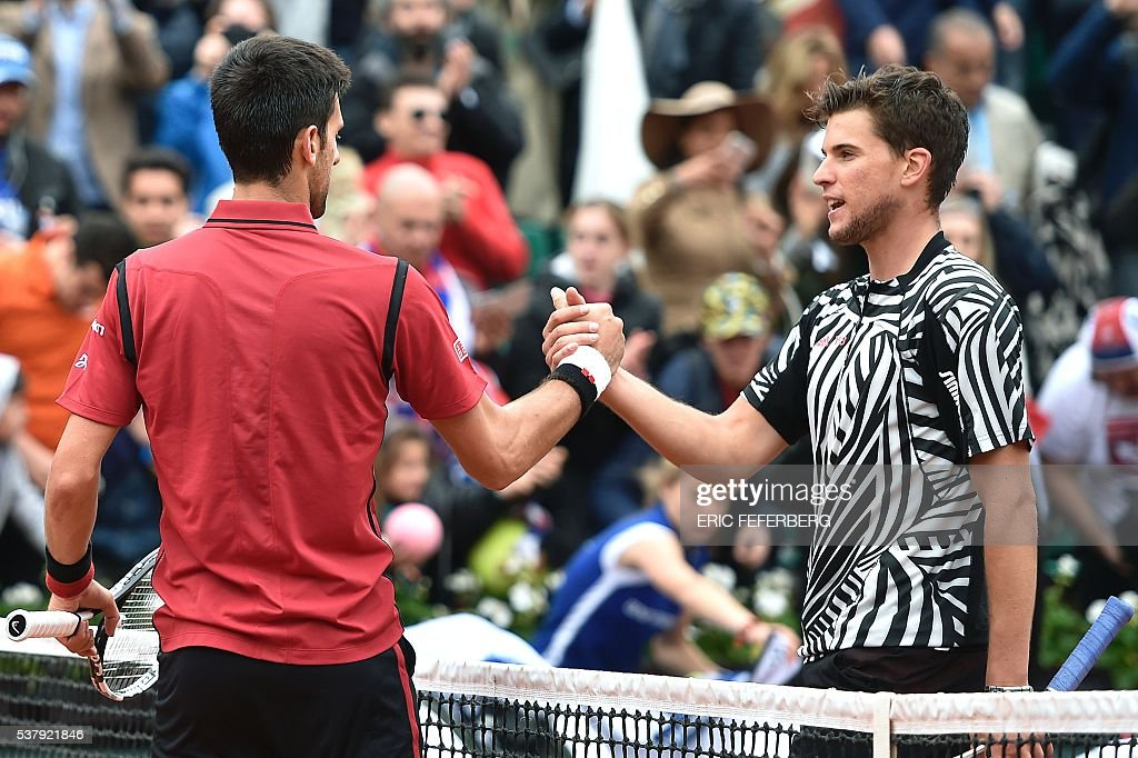 Austria's Dominic Thiem (R) shakes hands with Serbia's Novak Djokovic after losing their men's semi-final match at the Roland Garros 2016 French Tennis Open in Paris on June 3, 2016. / AFP / Eric FEFERBERG