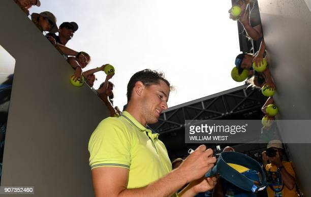 Austria's Dominic Thiem signs autographs after beating France's Adrian Mannarino in their men's singles third round match on day six of the...