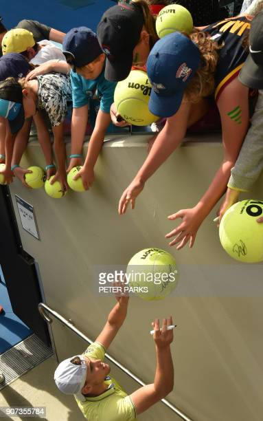 Austria's Dominic Thiem signs autographs after his men's singles third round match against France's Adrian Mannarino on day six of the Australian...