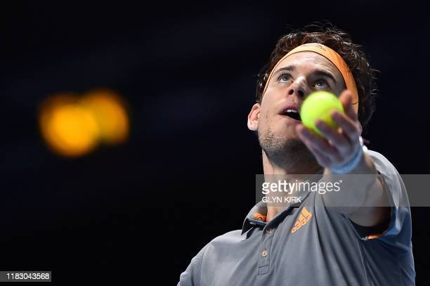 Austria's Dominic Thiem throws the ball to serve against Greece's Stefanos Tsitsipas during the men's singles final match on day eight of the ATP...