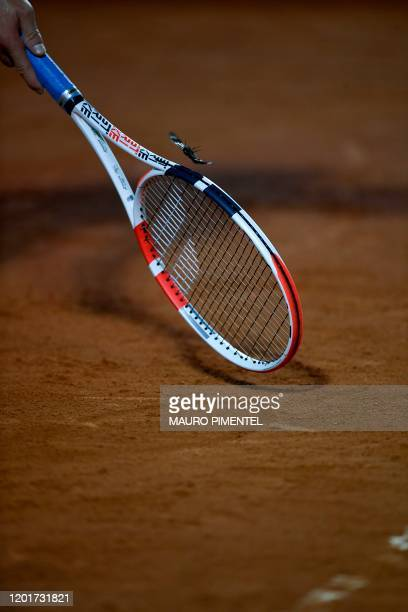 Austria's Dominic Thiem tries to remove a moth that flies around him with his racket during the ATP World Tour Rio Open singles match against...