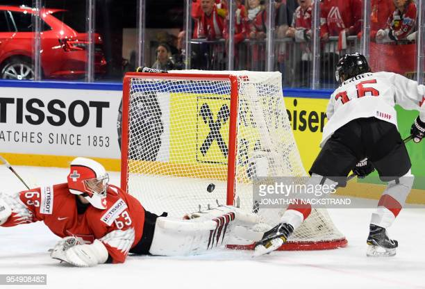 Austria's Dominic Zwerger shoots to score past Switzerland's goalie Leonardo Genoni during the group A match Switzerland vs Austria of the 2018 IIHF...