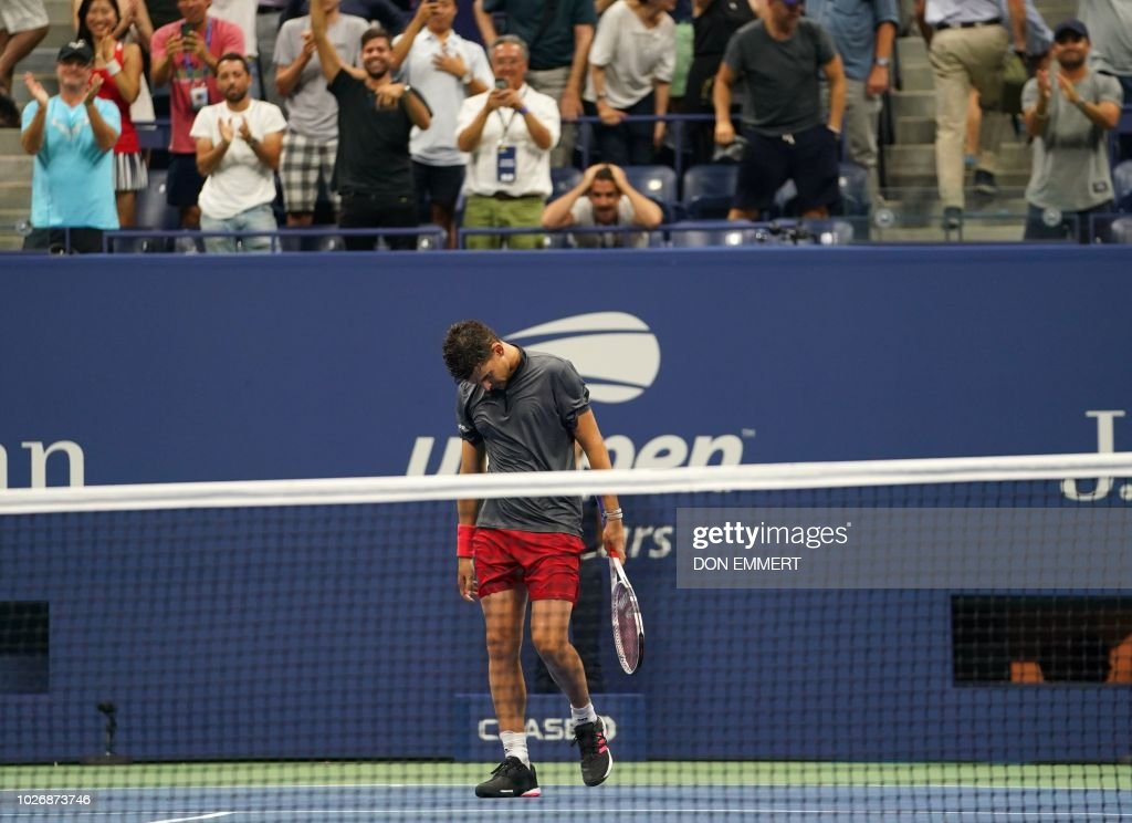 Austria's DominicThiem walks off the court as the crowd cheers after playing against Spain's RafaelNadal during their US Open tennis men's singles quarter-finals match September 5, 2018 in New York. - Defending champion Rafael Nadal survived an epic US Open quarter-final confrontation to defeat battling ninth seed Dominic Thiem 0-6, 6-4, 7-5, 6-7 (4/7), 7-6 (7/5) and reach the semi-finals for the seventh time.