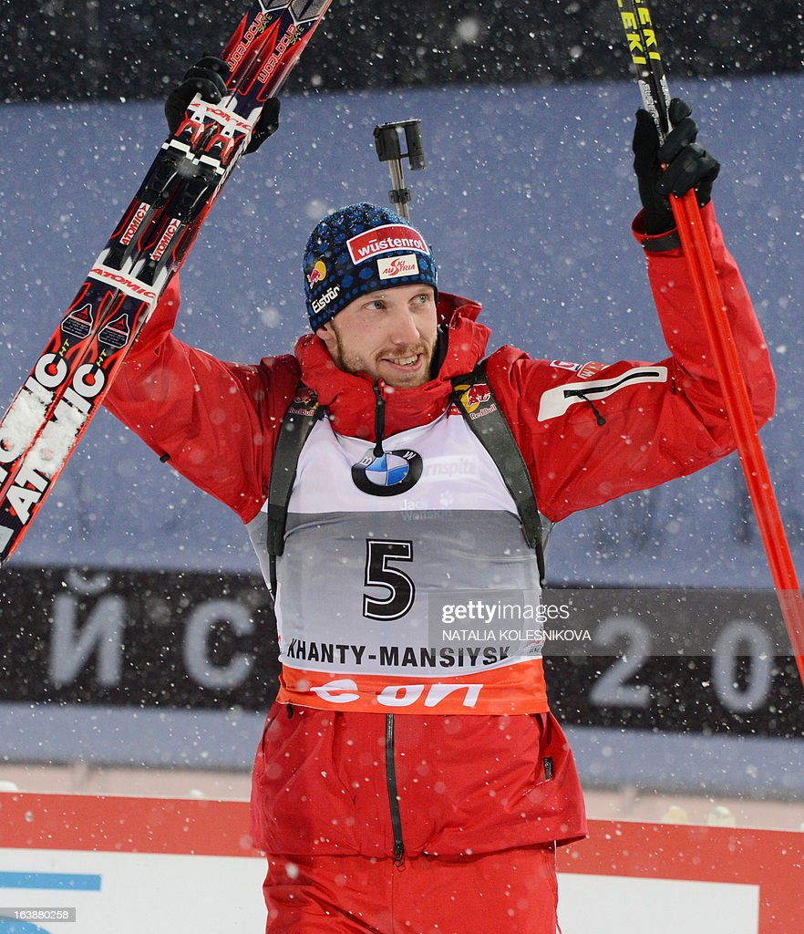 Austria's Dominik Landertinger celebrates on his way to the podium after the men's 15 km mass start event of the IBU Biathlon Word Cup in the Siberian city of Khanty-Mansiysk, on March 17, 2013. France's Martin Fourcade took the first place ahead of Austria's Dominik Landertinger and Norway's Emil Hegle Svendsen.