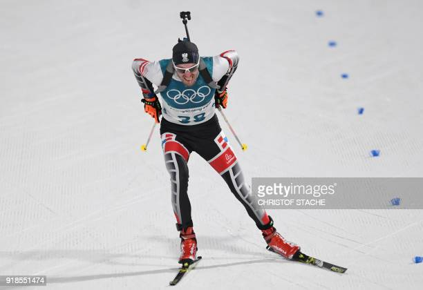TOPSHOT Austria's Dominik Landertinger crosses the finish line in the men's 20km individual biathlon event during the Pyeongchang 2018 Winter Olympic...