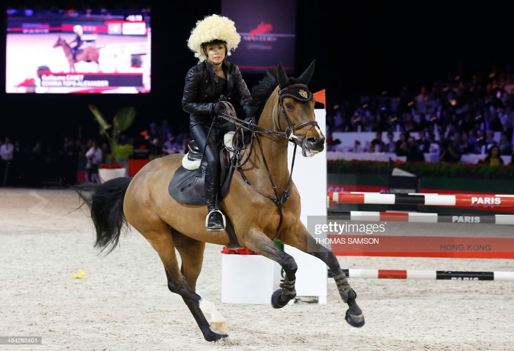 Austria's Edwina Tops-Alexander competes during the Style and Competition for Amade charity costumed event of the Paris Masters equestrian jumping competition on December 7, 2013 at the Parc des Expositions in Villepinte, north of Paris.