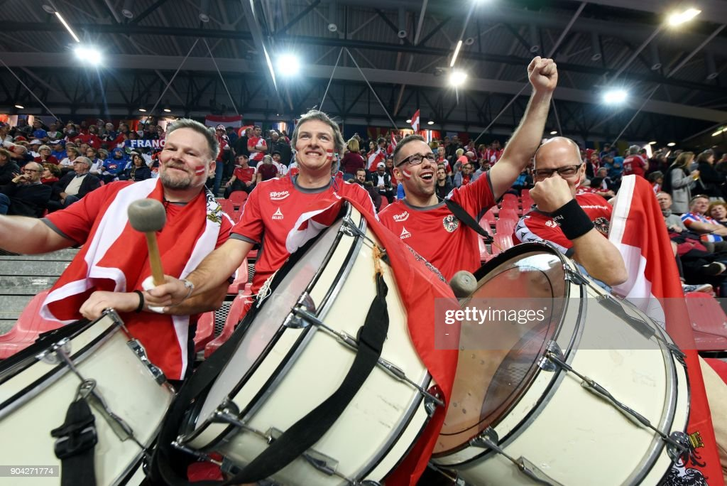 Austria's fans play drums during the preliminary round group B match of the Men's 2018 EHF European Handball Championship between Belarus and Austria in Porec, Croatia on January 12, 2018. /