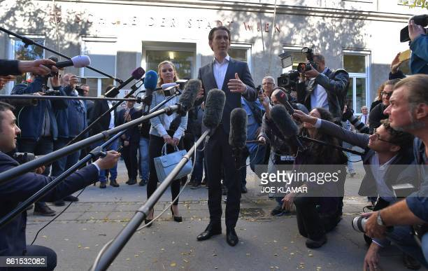 TOPSHOT Austria's Foreign Minister and leader of Austria's centreright People's Party Sebastian Kurz talks with journalists as his partner Susanne...