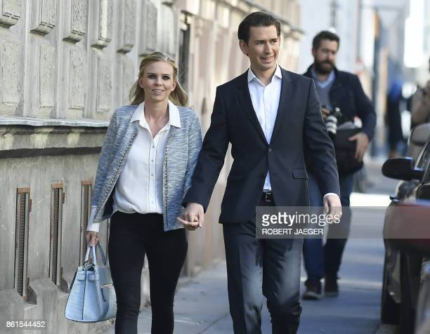 Austria's Foreign Minister and leader of Austria's centreright People's Party Sebastian Kurz and his partner Susanne Thier arrive at a polling...