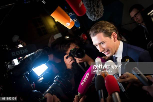 TOPSHOT Austria's Foreign Minister and leader of Austria's centreright People's Party Sebastian Kurz is surrounded by media as he arrives at Hofburg...