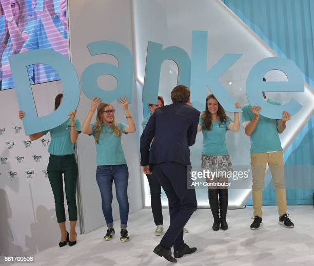 Austria's Foreign Minister and leader of Austria's centreright People's Party Sebastian Kurz arrives on stage as he greets supporters during the...